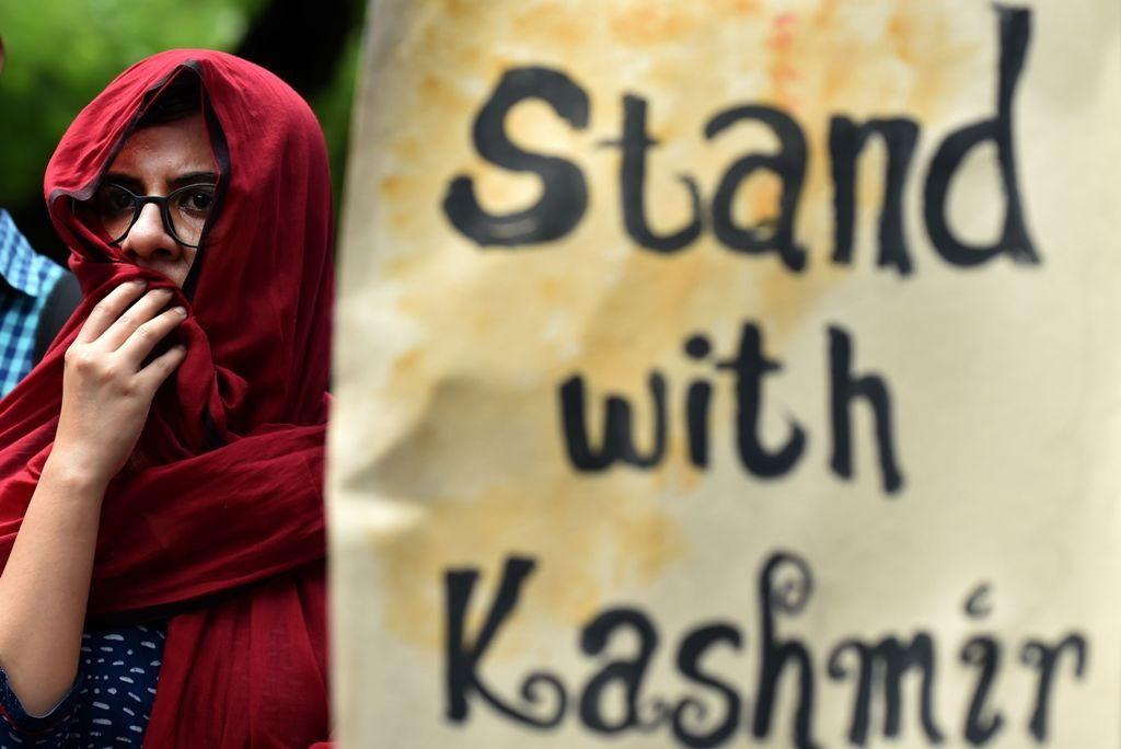 Indian students and social activists hold placards during a protest against the death of Kashmiri protestors in clashes between protestors and Indian security forces in India-administered Kashmir, in New Delhi on July 13, 2016. As the overall death toll from the violence rose to 32 on July 12, a senior state administrator said at least 1,000 people have been injured in the clashes in Kashmir, which is India's only Muslim-majority state, since Hizbul Mujahideen commander Burhan Wani was killed July 8. / AFP PHOTO / SAJJAD HUSSAIN